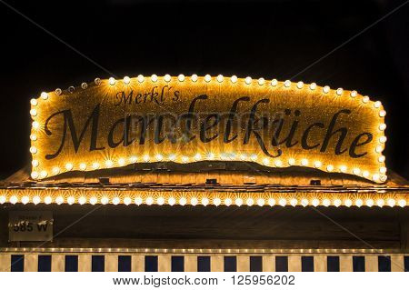 MUNICH, GERMANY - SEPTEMBER 18, 2015: Nightshot of the Merkel's Mandelkueche stall on Theresienwiese