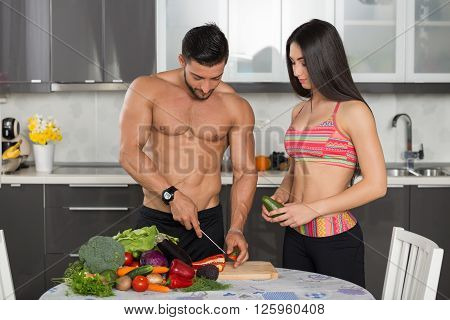 Young Fit Couple In The Kitchen