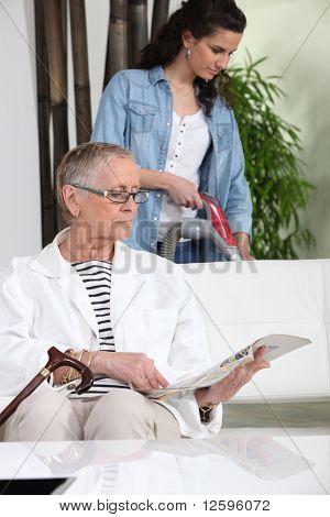 Female senior with a magazine before