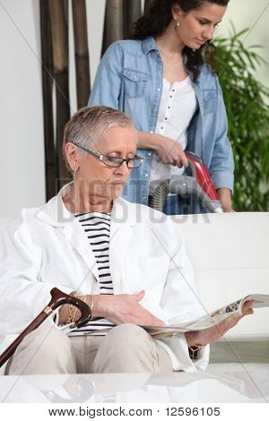 Woman sitting with a senior magazine