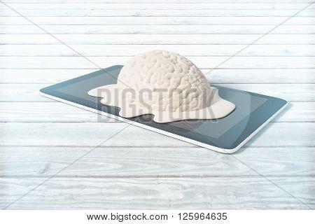 Mental degradation concept with brain melting on tablet placed on light wooden desktop. 3D Rendering