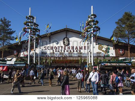 MUNICH, GERMANY - OCTOBER 02: Facade and entrance of the Schottenhamel beer tent on Theresienwiese with people standing in front