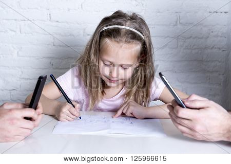 sweet cute little girl drawing alone while her parents spend their time networking with app on their mobile phone ignoring her daughter in parents internet addict neglecting their children
