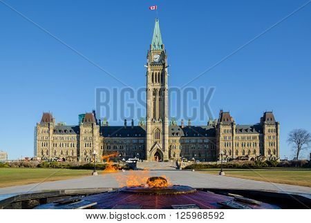 Parliament building in Ottawa Canada - Centre Block Peace Tower and Centennial Flame poster