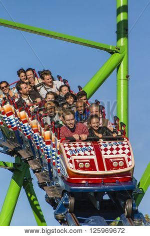 MUNICH, GERMANY - OCTOBER 02: The Alpinabahn rollercoaster on Theresienwiese at Oktoberfest is a famous fun ride and attracts many people