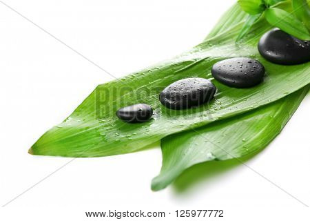 Hot spa stones with bamboo, isolated on white