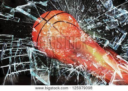 Basketball on fire through broken glass window.