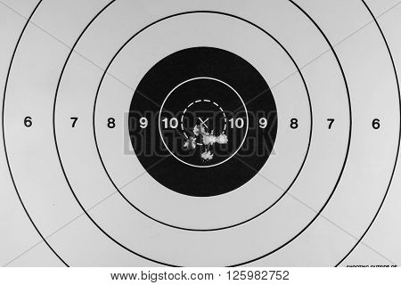 Nice tight grouping of five shots on a paper target