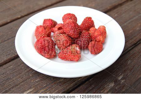 Freeze dired strawberries on wooden tabel background