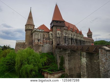 Beautiful panorama of the Corvin castle with wooden bridge and bench. Hunedoara,Transylvania, Romania, Europe