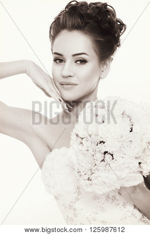 Vintage style shot of young beautiful bride with fancy prom hairdo