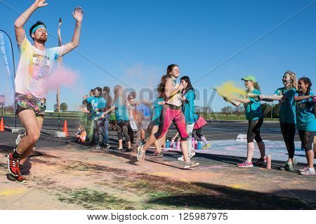 HAMPTON, GA - APRIL 2016: Runners get covered with colored corn starch at The Color Run in Hampton GA on April 2 2016 .