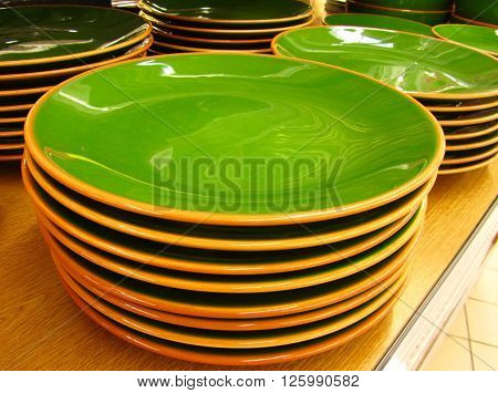 Shining Green Soup Plates in a Warehouse