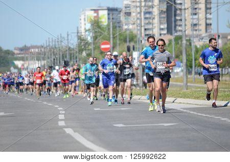 BELGRADE, SERBIA - APRIL 16: A group of marathon competitors during the 29th Belgrade Marathon on April 16, 2016 in Belgrade, Serbia