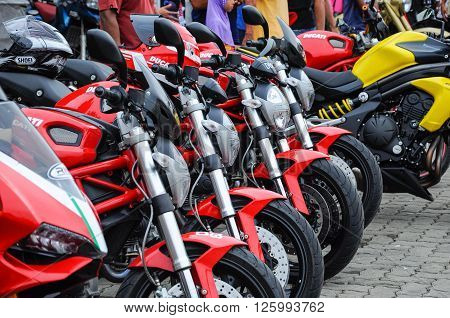 KELANTAN, MALAYSIA -JULY 07, 2012: A number of super bike motorcycle parked in rows in the open area and have been exhibited to the public.