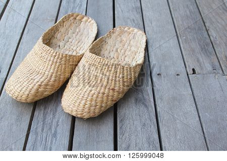 Vintage slippers handmade with bamboo on wood floor