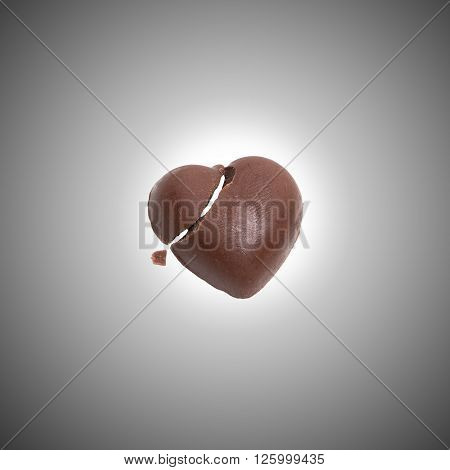 Broken Chocolate heart candy, chocolate candy concept, chocolate candy idea, chocolate candy background, chocolate candy valentine, chocolate candy isolated.