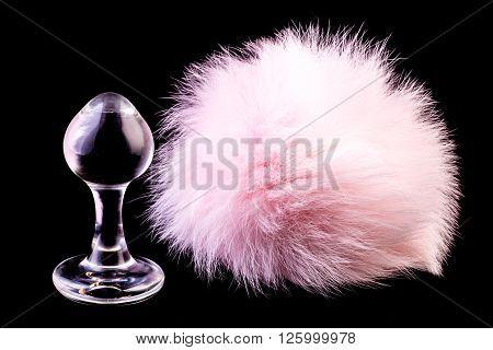 magnetic pink anal plug in black backgroud