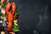 Shellfish plate of crustacean seafood with fresh lobster, mussels, shrimps, oysters as an ocean gourmet dinner background poster