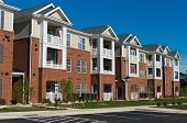 Newly constructed  typical suburban apartment building exterior poster