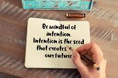 Handwritten quote Be mindful of intention. Intention is the seed that creates our future, as inspirational concept image poster