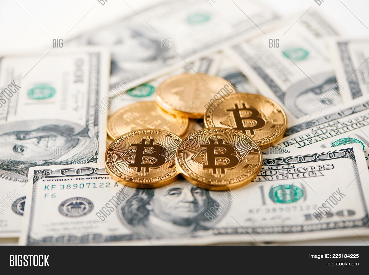 Shiny Golden Bitcoins Lying On Hundred Dollar Bills Presenting Gest Cryptocurrency And New Futuristic Form Of