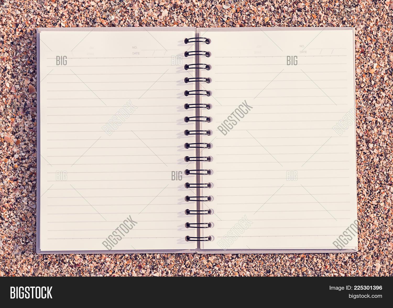 Notebook On Beach Powerpoint Template Notebook On Beach Powerpoint