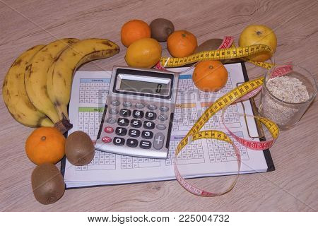 Measure tape and fresh fruit. Healthy lifestyle diet with fresh fruits. Low-calorie fruit diet. Diet for weight loss