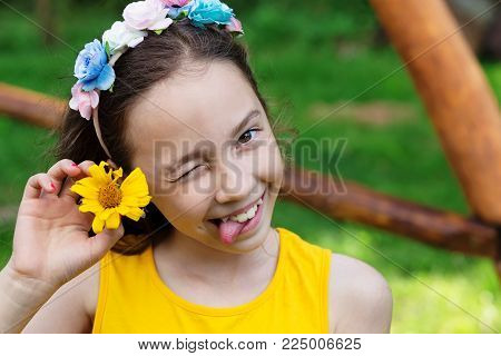 Portrait of cute preteen girl smiling with tongue sticking out