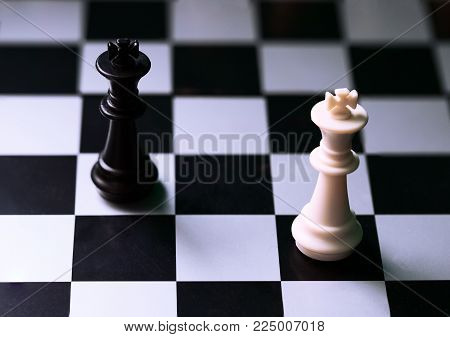 White and black chess figures on board. Chess game position. Black and white king. Pawns and rook protecting king. Chess figurine order. Checkmate game banner template. Intellectual sport. Tactic game