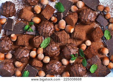 Chocolate shonfet with praline, truffles, chocolate, cocoa. Chocolate photo background.