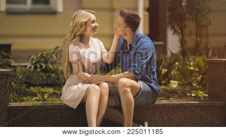 Sweet young lady touching beloved mans face tenderly, love story, relationship, stock video poster