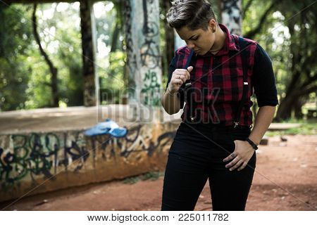 Stylish Girl Holding Suspenders
