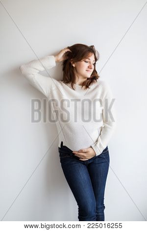 clothing, motherhood, beauty concept. there is a wonderful woman, who is preparing to be a mother, she is eight months pregnant and looks very fresh and beautiful