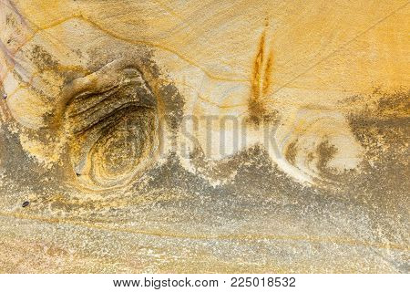Natural sand stone texture and seamless background.