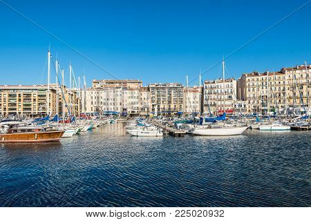 Marseille, France - December 4, 2016: Cityscape with moored yachts and boats in Old Vieux Port of Marseille, Provence, France.