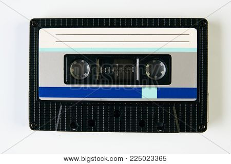 Retro compact audio cassette. Vintage cassette tape isolated white background, close-up top view. Cassetes year 1980