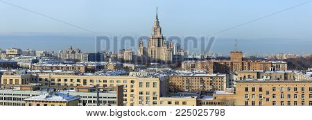 Panoramic view of the South-Western district of Moscow with the main building of Lomonosov Moscow State University in the middle. Moscow, Russia.