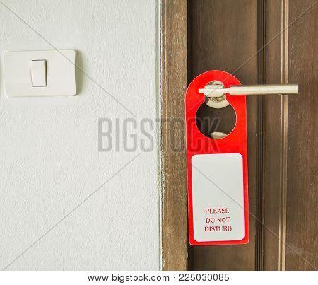 Please Do Not Disturb Sign, Hang On Doorknob Of Hotel Room