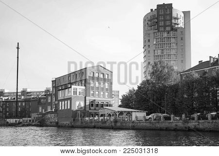 Kaliningrad, Russia - may 11, 2016: Modern buildings on the banks of the river Pregolya in black-and-white image.