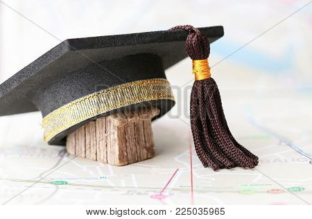 Graduate study abroad inter school concept : Graduation cap on on  Bangkok city map. Mortarboard Graduate international study program and Back to School or road to succes in life, empty space for text