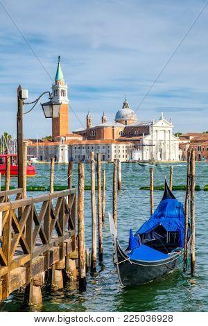 Gondola near St Marks Square in Venice with the church of San Giorgio Maggiore on the background