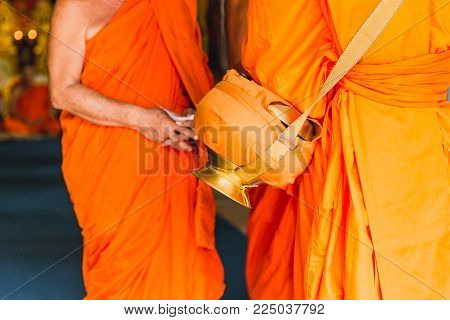 Thai ordained situation monk ceremony or monkhood with monk bowl of buddhist man in temple Thailand