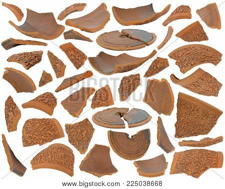 Various broken brown ceramic shards at various angles isolated on white background