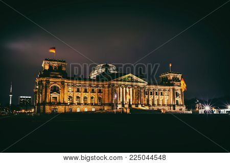 Illuminated Reichstag building at night in Berlin, Germany