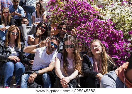 Rome, Italy - April 22, 2017: Cheerful Tourists Sitting On The Spanish Steps (piazza Di Spagna), Sta