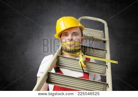 Clumsy construction worker with ladder and measure tape