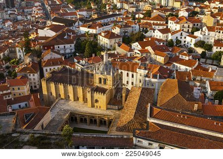 Coimbra Panorama From Top Of Bell Clock Tower. Old Coimbra Cathedral With Dome And Cloister.