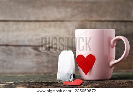 Cup Of Tea With Red Heart And Teabag On Wooden Table