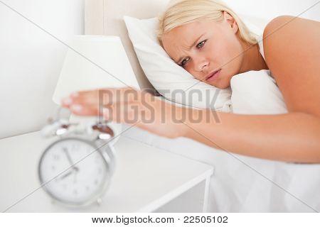 Unhappy Woman Awaken By An Alarmclock